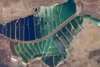 Satellite view of salt evaporation ponds in Jordan-Israel border--Photographic Print