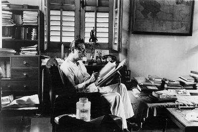 Satyajit Ray at Work in His Apartment--Photographic Print