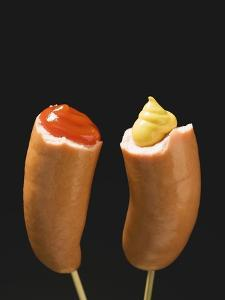 Sausages with Ketchup and Mustard on Wooden Cocktail Sticks