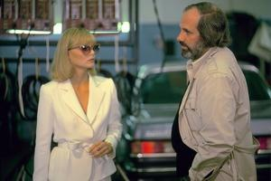 SCARFACE, 1983 directed by BRIAN by PALMA On the set, Michelle Pfeiffer with the director, Brian by