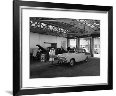 Scene in Globe and Simpsons Auto Electrical Workshop, Nottingham, Nottinghamshire, 1961-Michael Walters-Framed Photographic Print