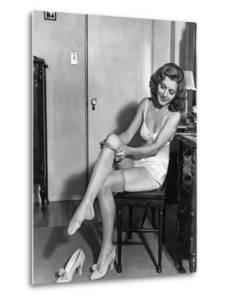 Woman Putting on Stockings, 1933 by Scherl S?ddeutsche Zeitung Photo