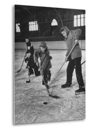 Schoolboys Playing Ice Hockey