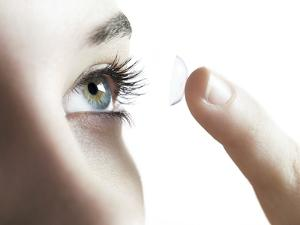 Contact Lens Use by Science Photo Library