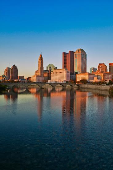 Scioto River and Columbus Ohio skyline in autumn with sunset reflection in water--Photographic Print