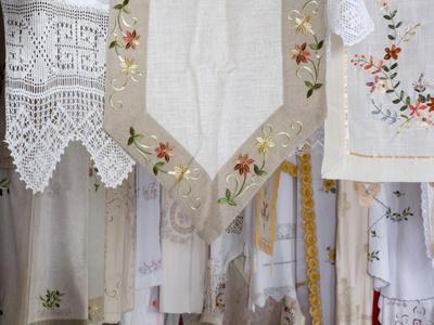 Greece, Crete. Lace and embroidery in shop in town of Kritsa. Lasithi Region.