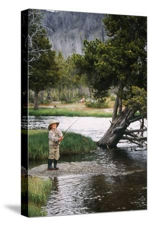 Boy Fishing at Firehole River, Wyoming, USA