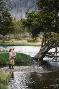 Boy Fishing at Firehole River, Wyoming, USA by Scott T. Smith