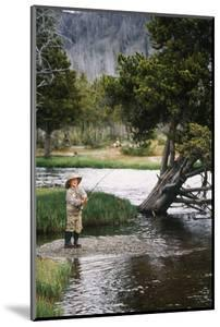 Boy Fishing at Firehole River, Wyoming, USA by Scott T^ Smith