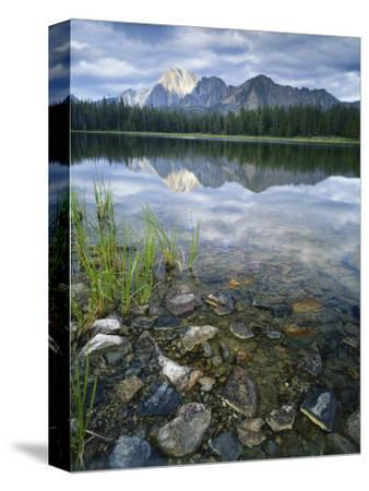 Stones Along Shore of Frog Lake with Mountain Peaks in Back, Sawtooth National Recreation Area, USA