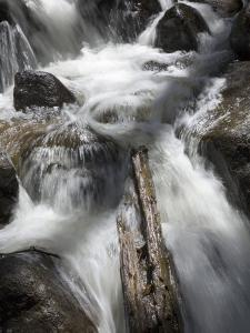 Fast Water Cascading over Jagged Rocks at Calypso Cascades by Scott Warren