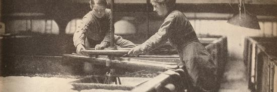 Screwing Down the Yeast in a Burton-On-Trent Brewery', c1916, (1935)-Unknown-Photographic Print