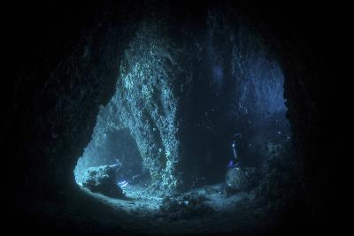 Scuba Divers Explore a Cave Near the Island of Sulawesi, Indonesia-Stocktrek Images-Photographic Print