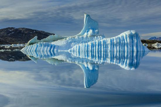 Sculpted iceberg and reflection in Semerlik Fjord.-Ralph Lee Hopkins-Photographic Print