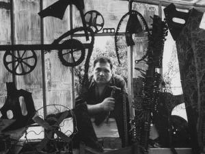 Sculptor Edwardo Paolozzi Posing in His Studio