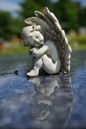 https://imgc.artprintimages.com/img/print/sculpture-of-an-angel_u-l-pt9nto0.jpg?p=0