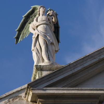 Scuola Grande Di San Fantin, Venice - Statue of Angel with Wings Above Pediment (Detail)-Mike Burton-Photographic Print