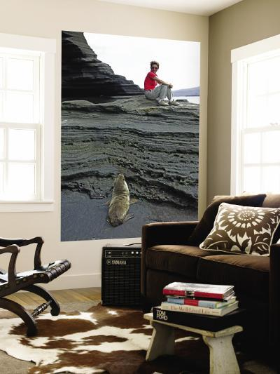 Sea Lion Cub Watching Visitor on Eroded Lava Rocks at Puerto Egas-Manfred Gottschalk-Wall Mural