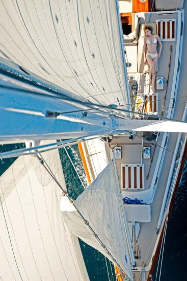 Sea of Cortez, Mexico: A Girl Sunbathes on a Sailboat as Seen from the Tip of the Mast-Ben Horton-Photographic Print