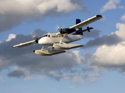 Sea Plane Flies Amid the Clouds-Pete Ryan-Photographic Print