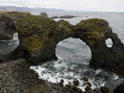 Sea Pounds Volcanic Rock Along the Coast of Iceland-Annie Griffiths Belt-Photographic Print