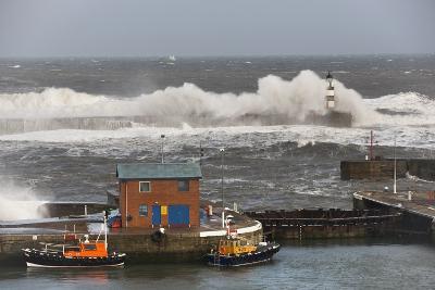 Seaham, Teesside, England; Waves Crashing into a Lighthouse and Boats Along a Pier-Design Pics Inc-Photographic Print