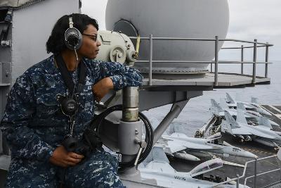 Seaman Observes Flight Operations Aboard USS Ronald Reagan--Photographic Print