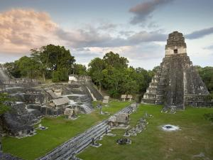 Grand Plaza with Temple of Great Jaguar (Temple I) at Right, in Mayan Ruins of Tikal by Sean Caffrey