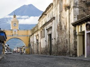 Volcan De Agua Looming Behind Santa Catalina Arch by Sean Caffrey