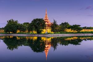 Mandalay, Myanmar at the Palace Wall and Moat by Sean Pavone