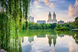 New York City, USA at the Central Park Lake and Upper West Side Skyline. by Sean Pavone