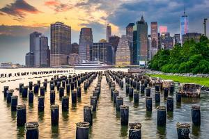 New York City, USA City Skyline on the East River. by Sean Pavone
