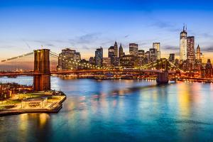 New York City, USA Skyline over East River and Brooklyn Bridge. by Sean Pavone