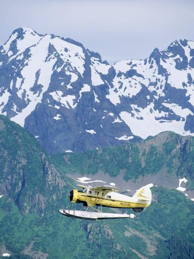Seaplane in Flight Near Mountains, AK-Jim Oltersdorf-Photographic Print