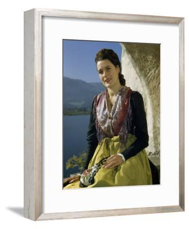 Seated Woman Wears Dirndl Skirt and Holds Heirloom Handbag-Volkmar K^ Wentzel-Framed Photographic Print