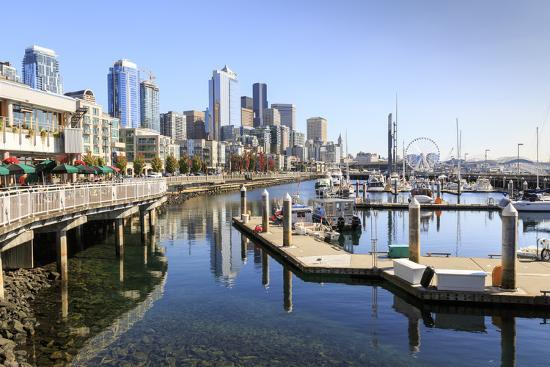 Seattle Skyline And Restaurants On Sunny Day In Bell Harbor Marina