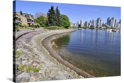 Seawall and Cityscape--Stretched Canvas Print