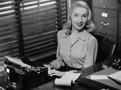 Secretary Sitting at Manual Typewriter, Portrait-George Marks-Photographic Print