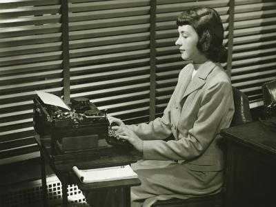 Secretary Typing on Typewriter in Office-George Marks-Photographic Print