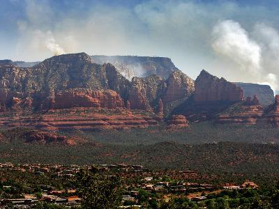 Sedona, Ariz. is Backdropped by the Brins Fire Buring Atop the Red Rocks--Photographic Print