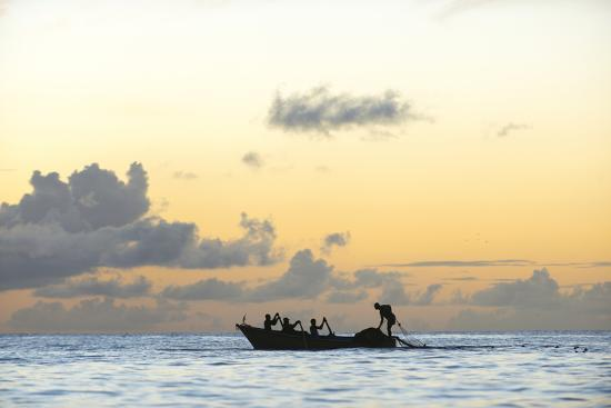 Seine fisherman lay their nets from a boat in Castara Bay in Tobago at sunset, Trinidad and Tobago-Alex Treadway-Photographic Print