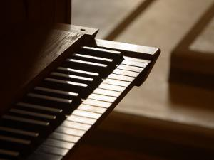 Selective Focus of Piano Keys with Stairs in the Background