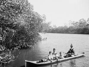 Seminole Indian and Family Dugout Canoe, Miami, Florida, C.1910-20