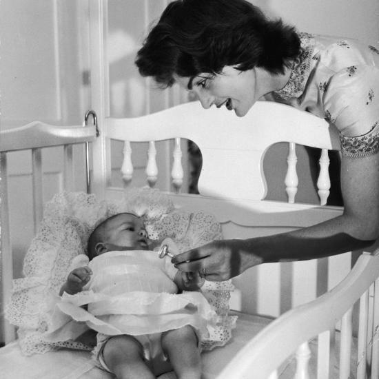 Sen. John Kennedy's Wife Jacqueline Offering Baby Caroline a Silver Rattle at their Georgetown Home-Nina Leen-Premium Photographic Print