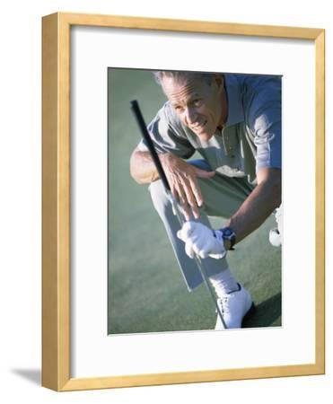 Senior Man Holding a Golf Club