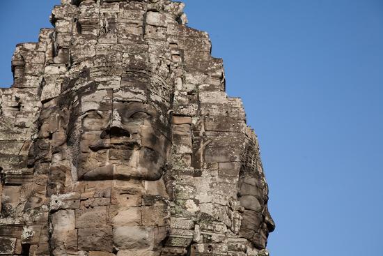 Serene Faces Sculpted into the Exterior Walls of Bayon Temple, Angkor Wat-Erika Skogg-Photographic Print