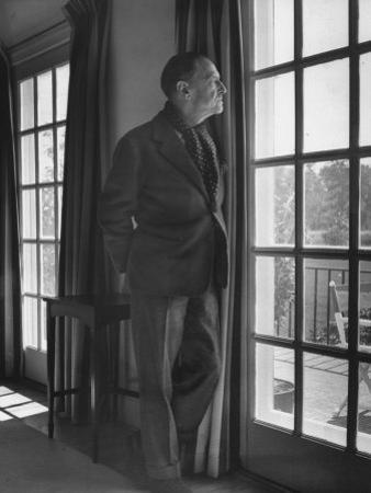 Author Somerset Maugham Gazing Out French Window onto Patio, at Home