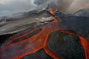 Tolbachik Volcano Erupting with Lava Flowing Down the Mountain Side by Sergey Gorshkov