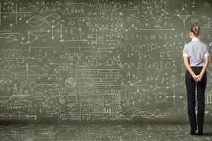 Business Person Standing Against the Blackboard with a Lot of Data by Sergey Nivens