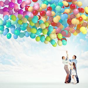 Family Holding Colorful Balloons by Sergey Nivens